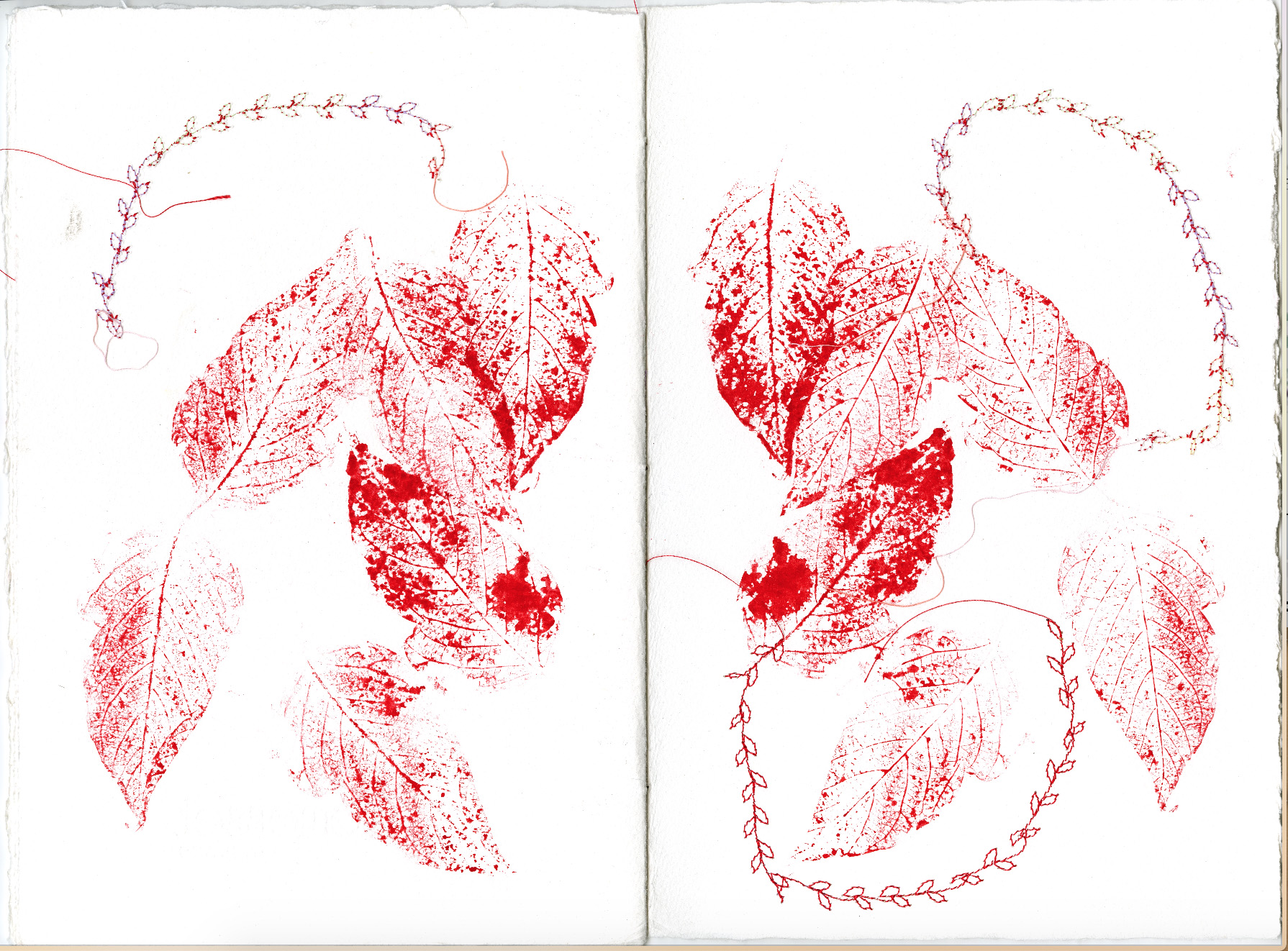 spread with red leaf prints