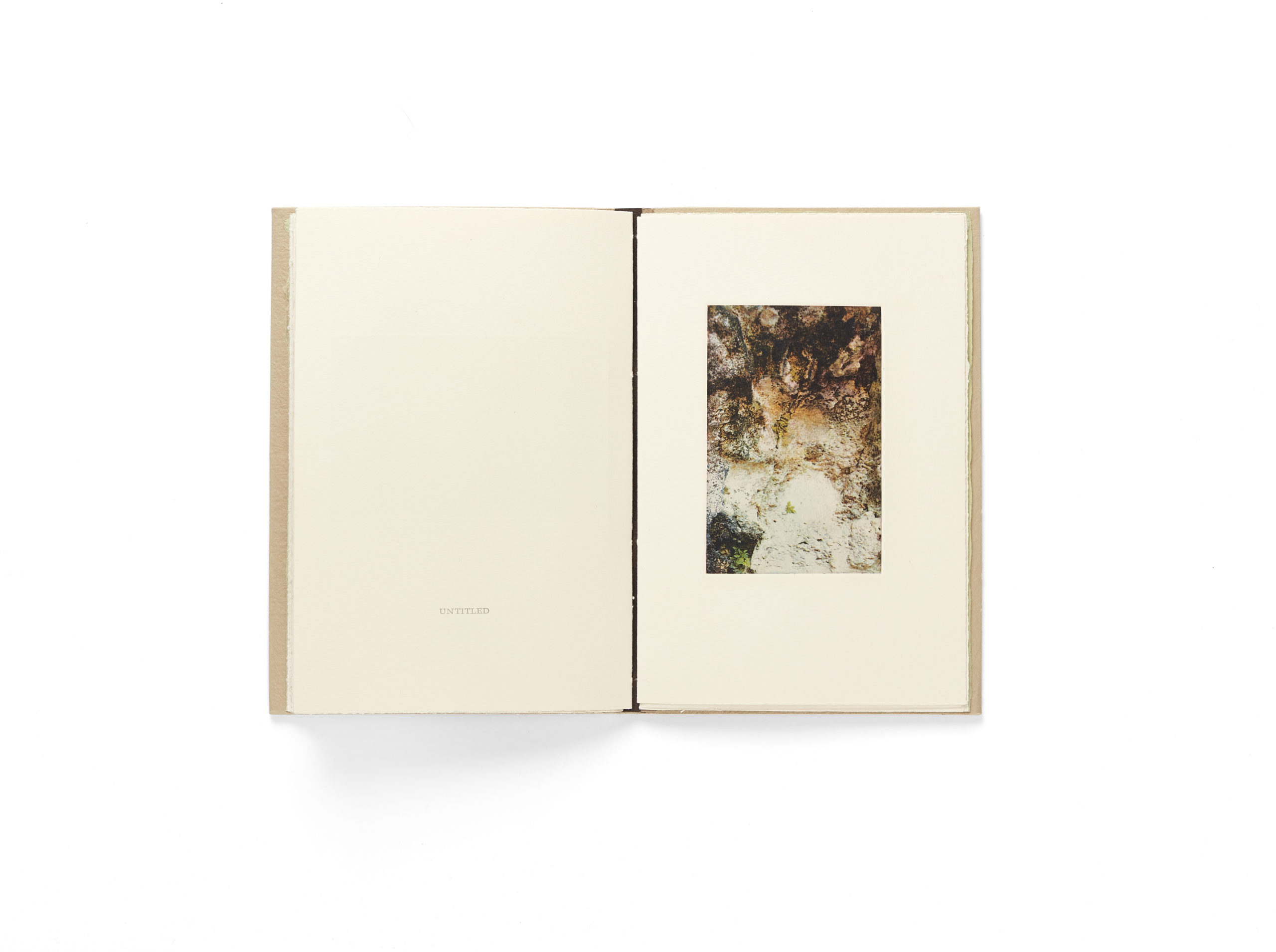 book spread with photo of body shape in ground