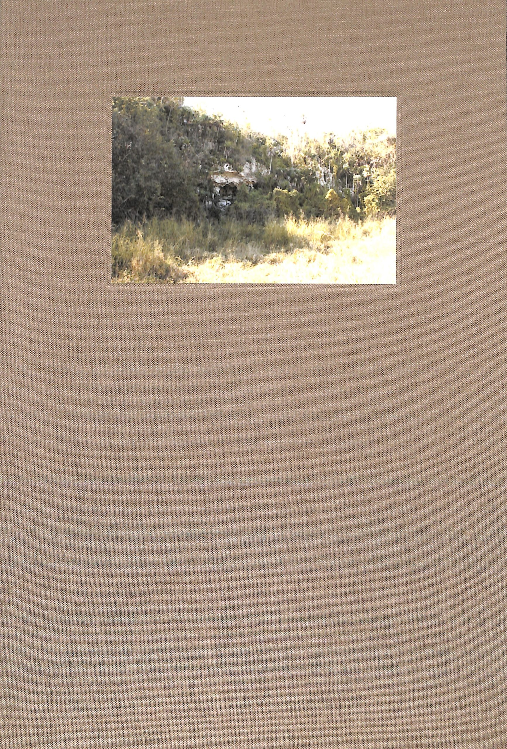tan clamshell box with small landscape photo