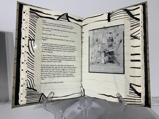 book open to spread of text and image with woodcut printed margins