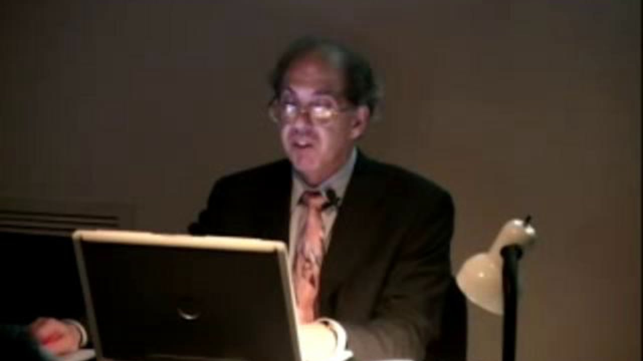 Richard Minsky reading at a podium