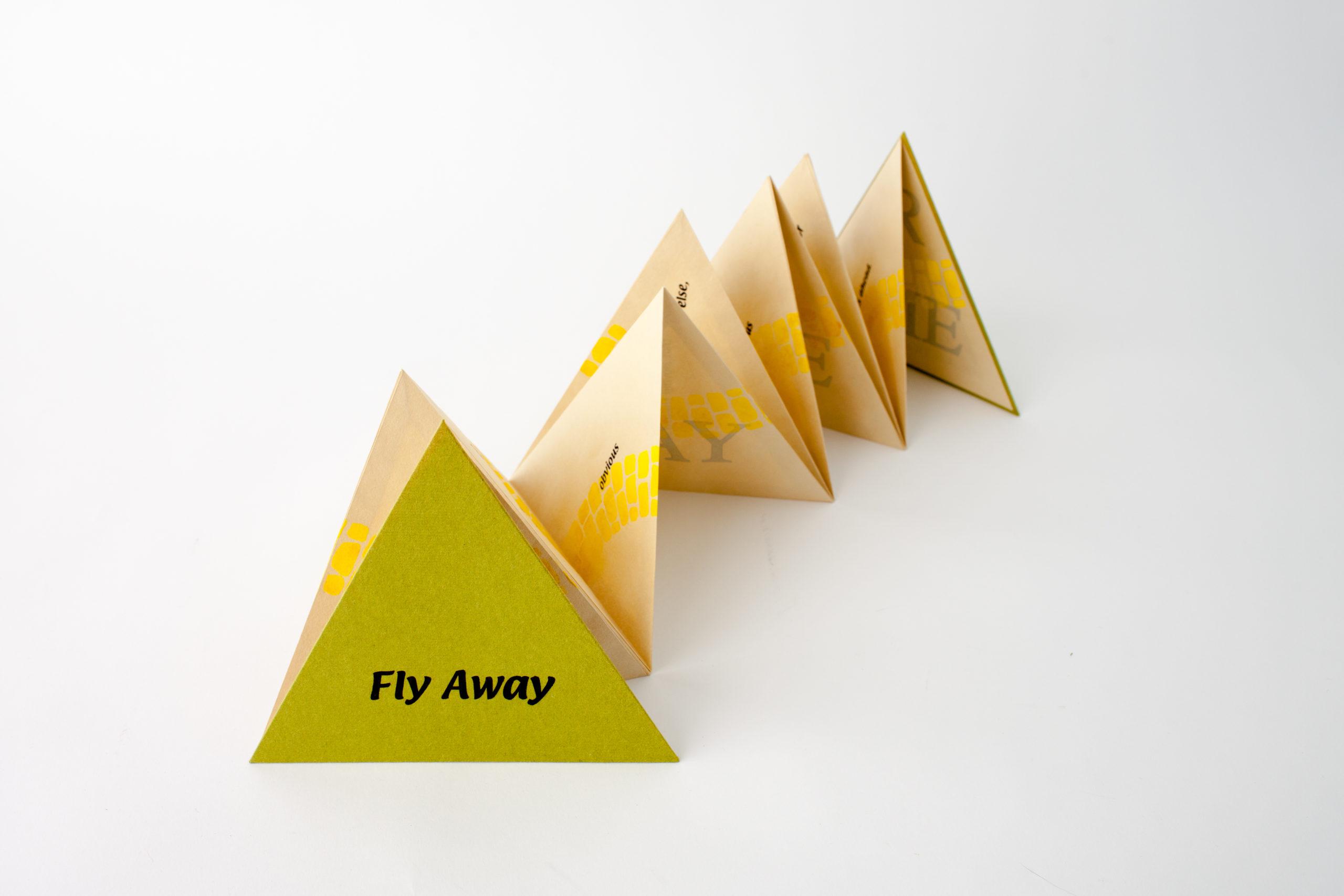 yellow trianglar accordion book