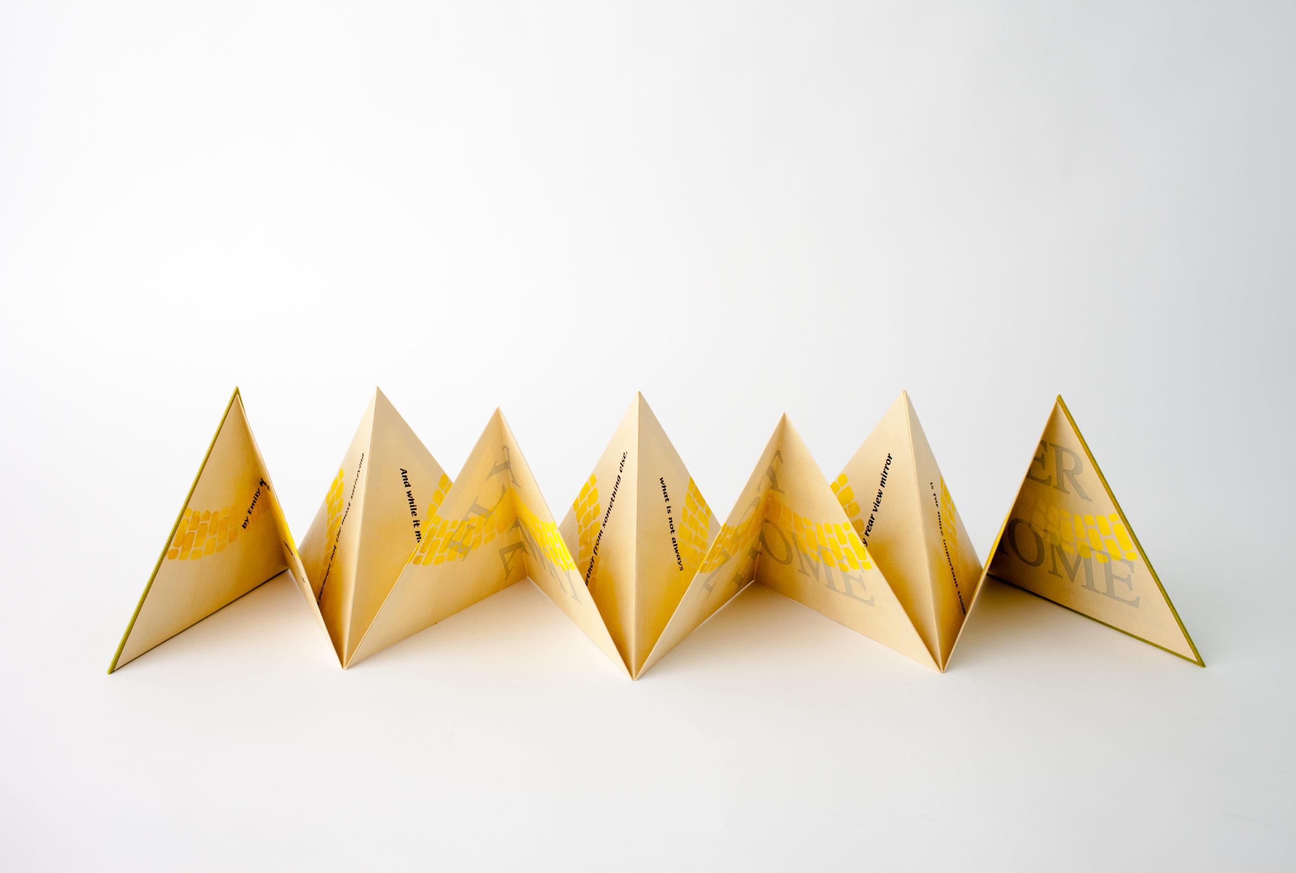 yellow triangular accordion book