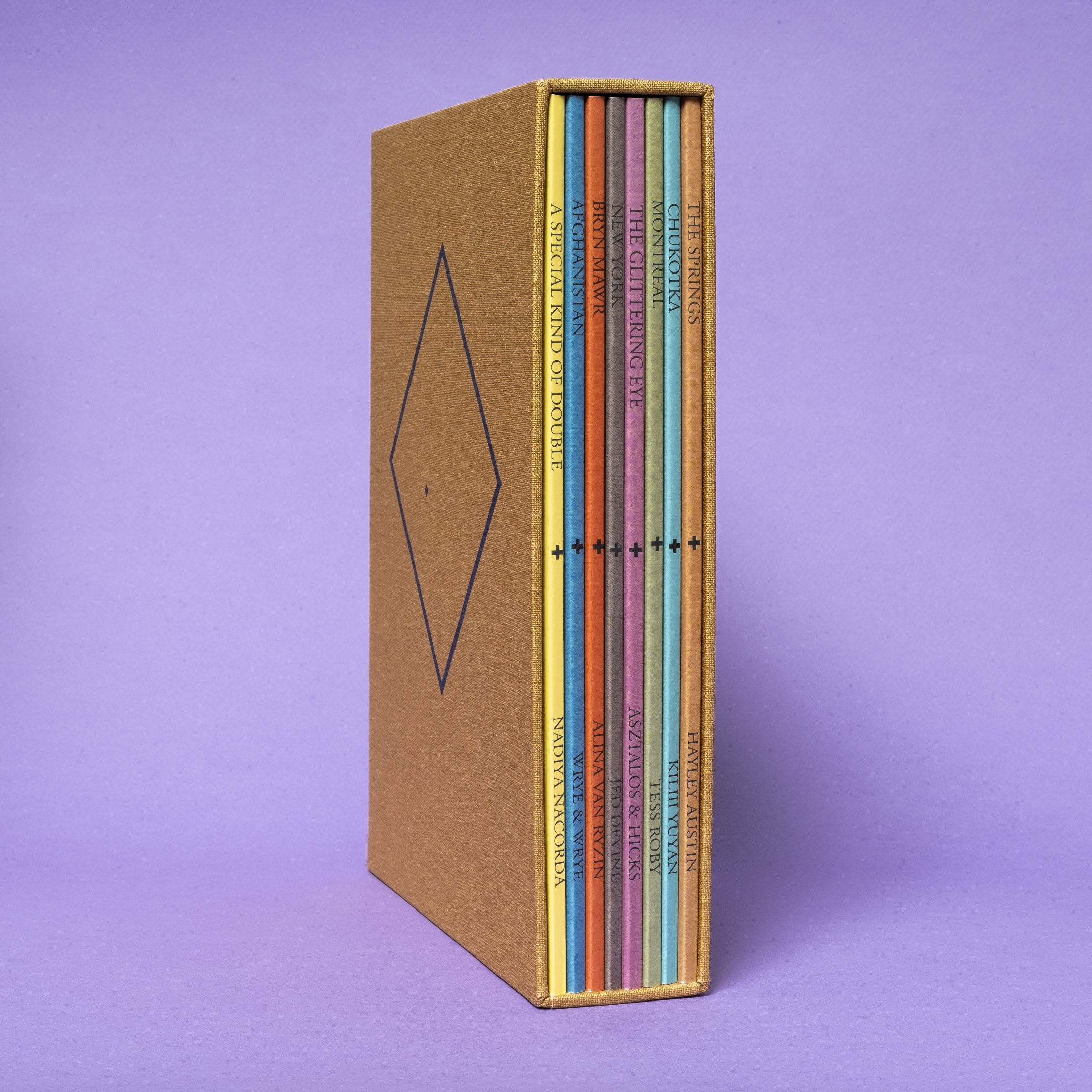 Slipcase with eight different colored books
