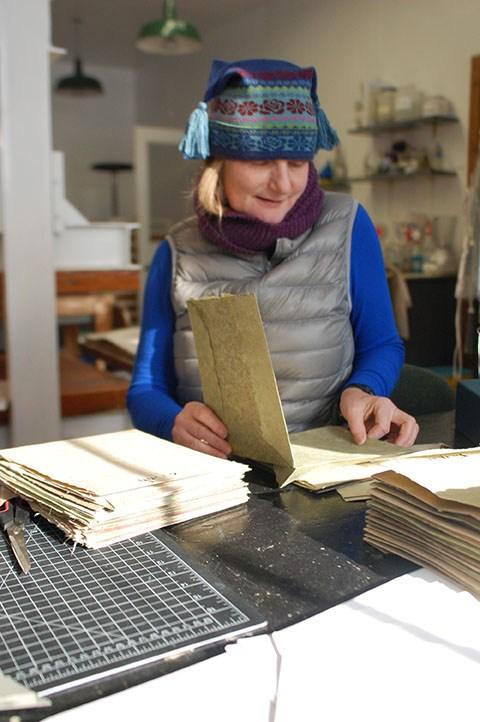 Susan Mills working on a book at Women's Studio Workshop