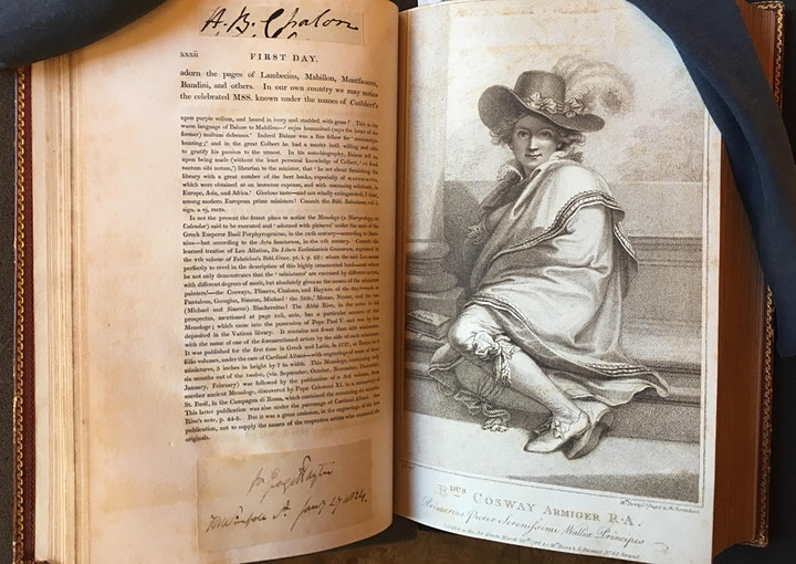 Photo of an open book with an engraving of a man if fancy clothes