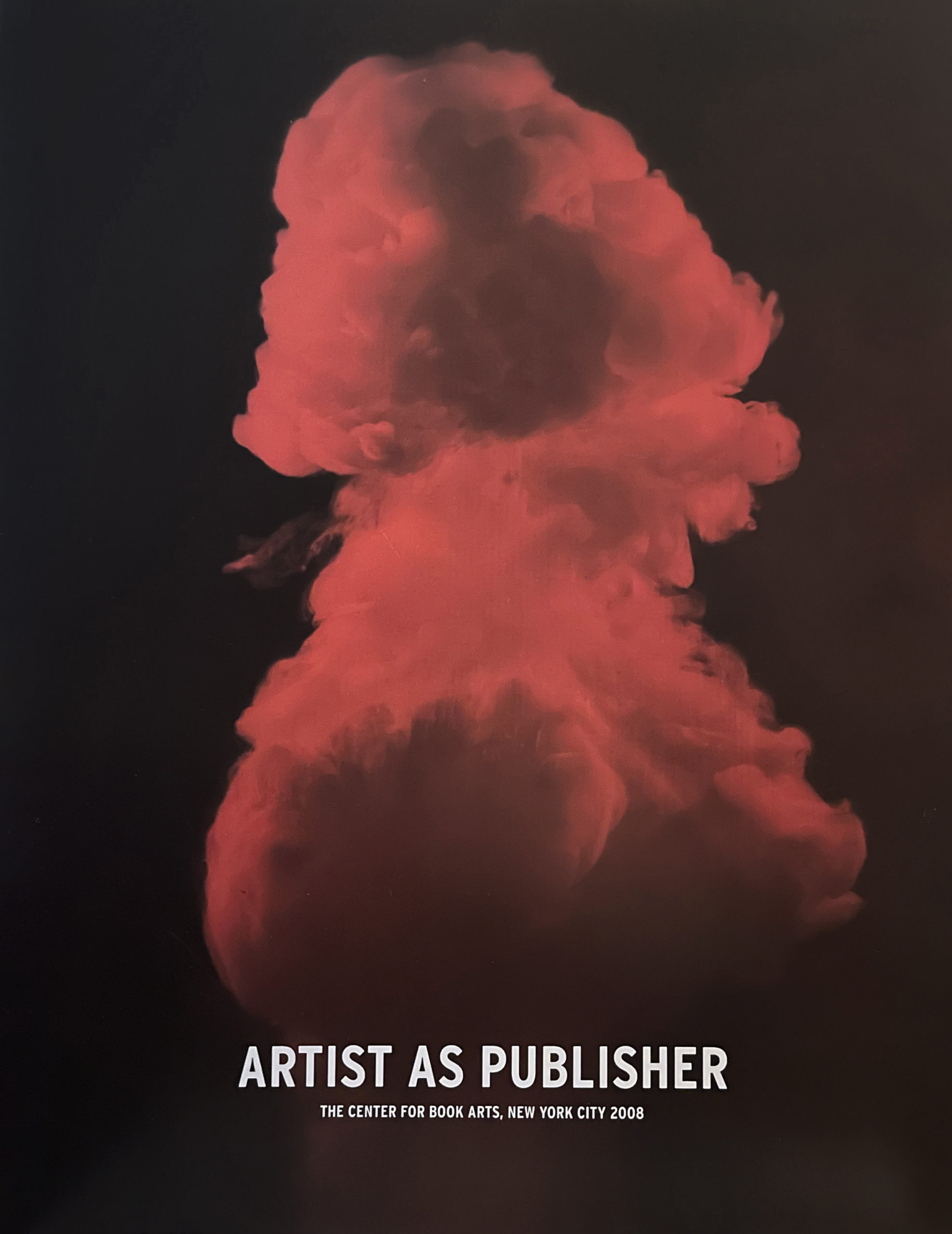black book cover with red mushroom cloud