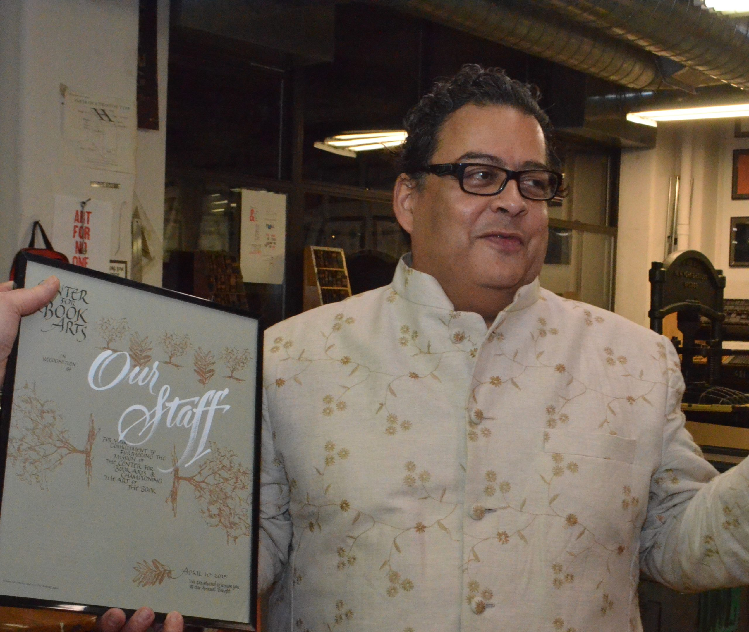 Medium skin hispanic man holding award