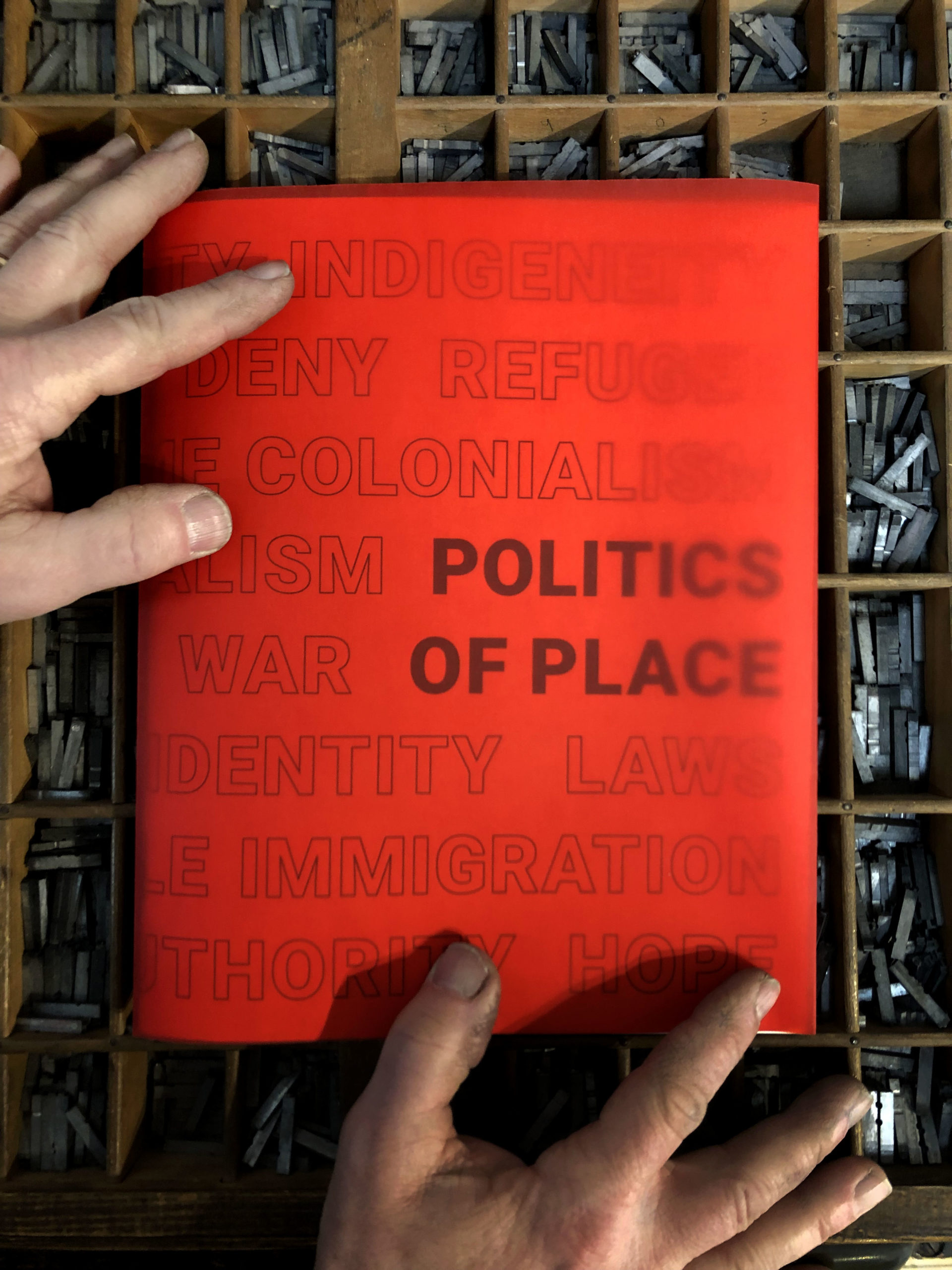 """red book cover with the title """"Politics of Place"""""""