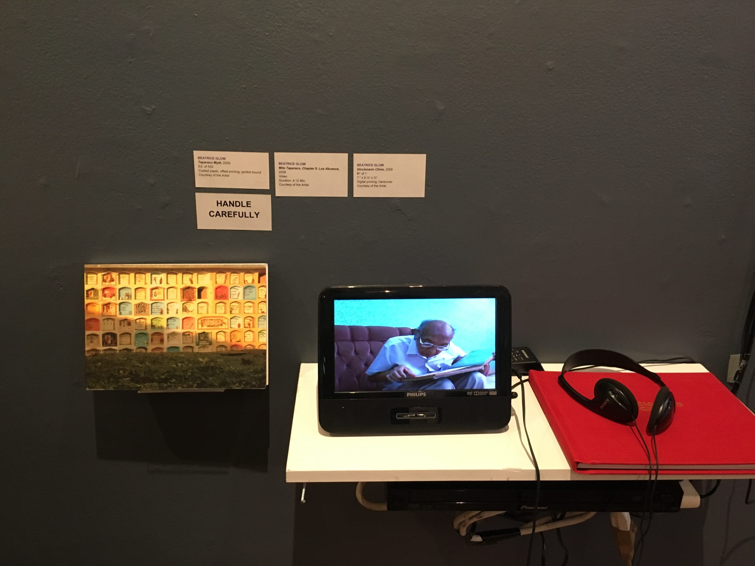 books and tablet with video