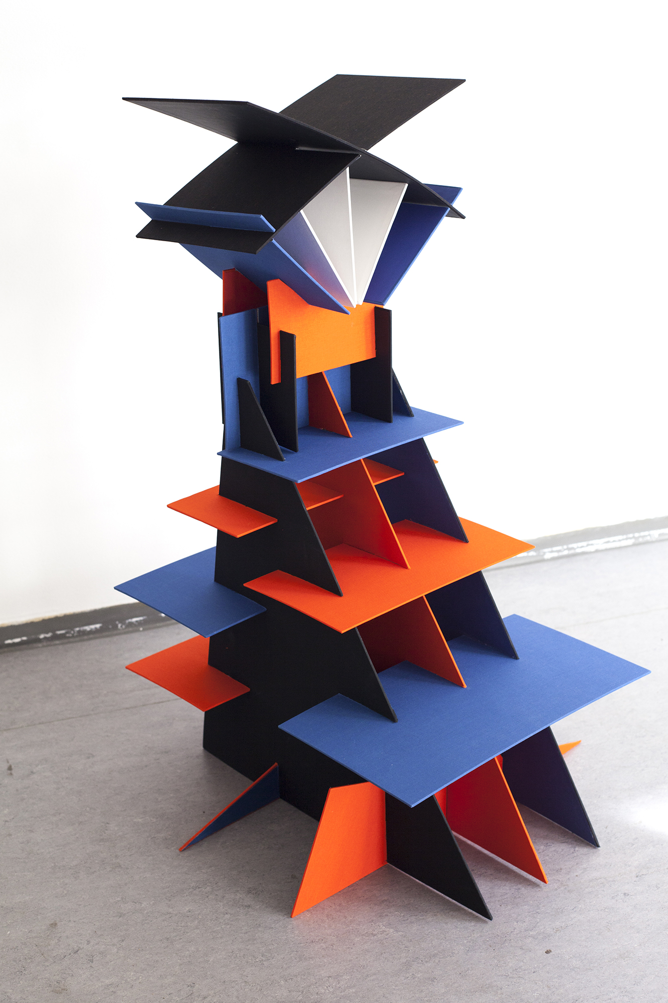 Sculptural book art object made of book cover material in bright colors