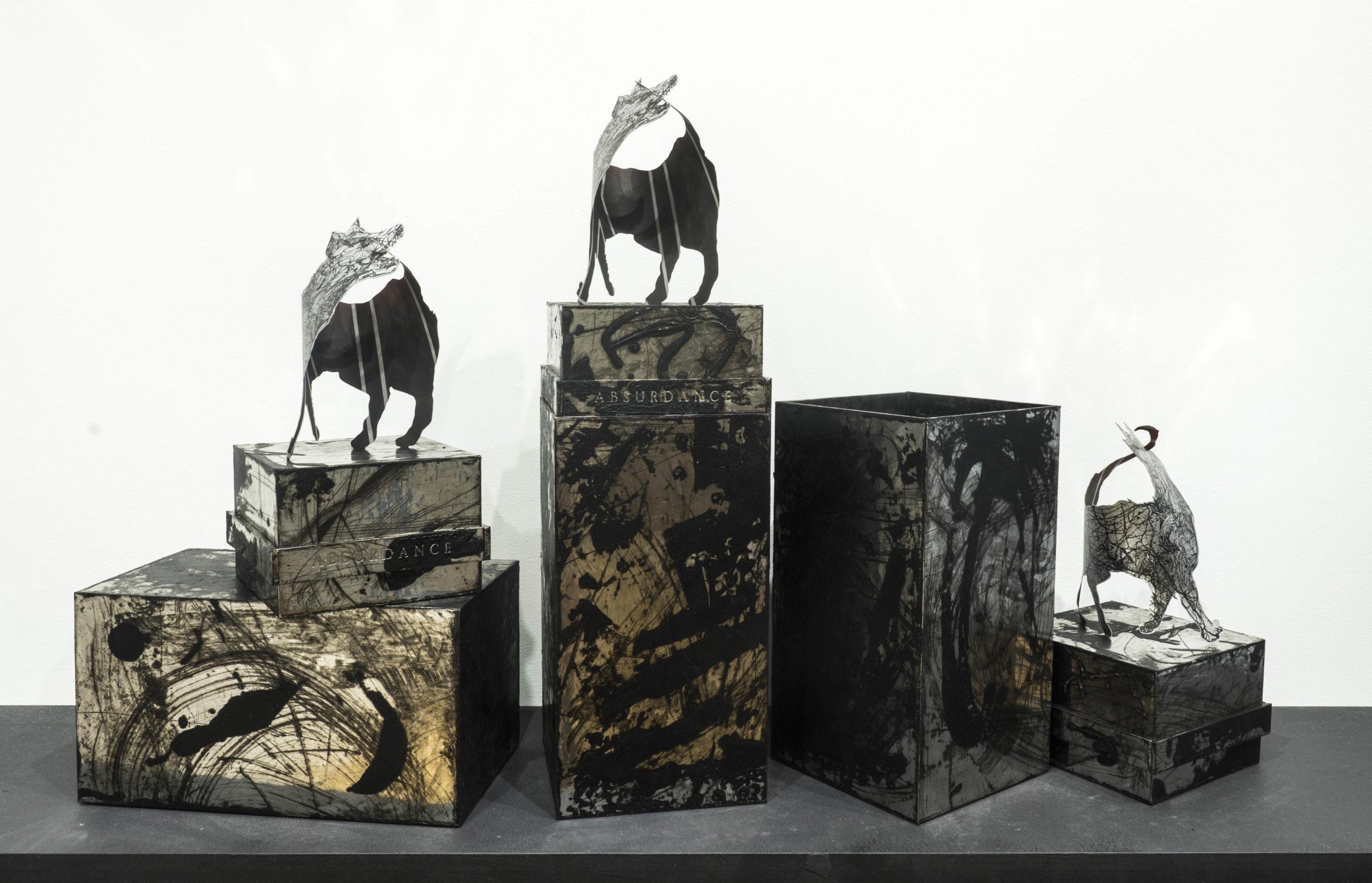 Three Sculptures of metallic Paper Dogs