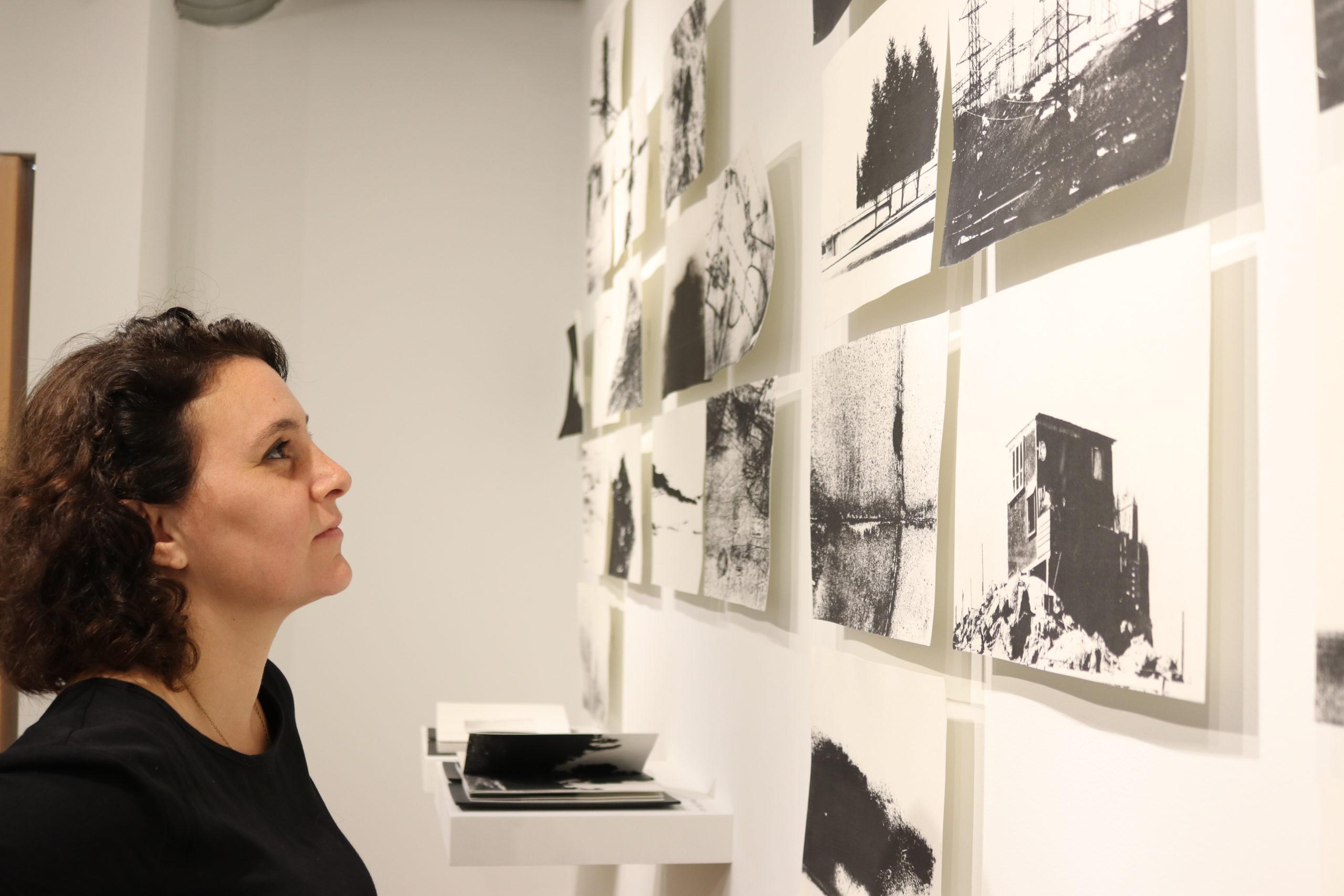 artist looks at her artwork