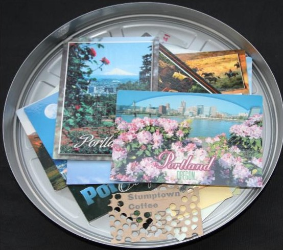 movie tin filled with postcards