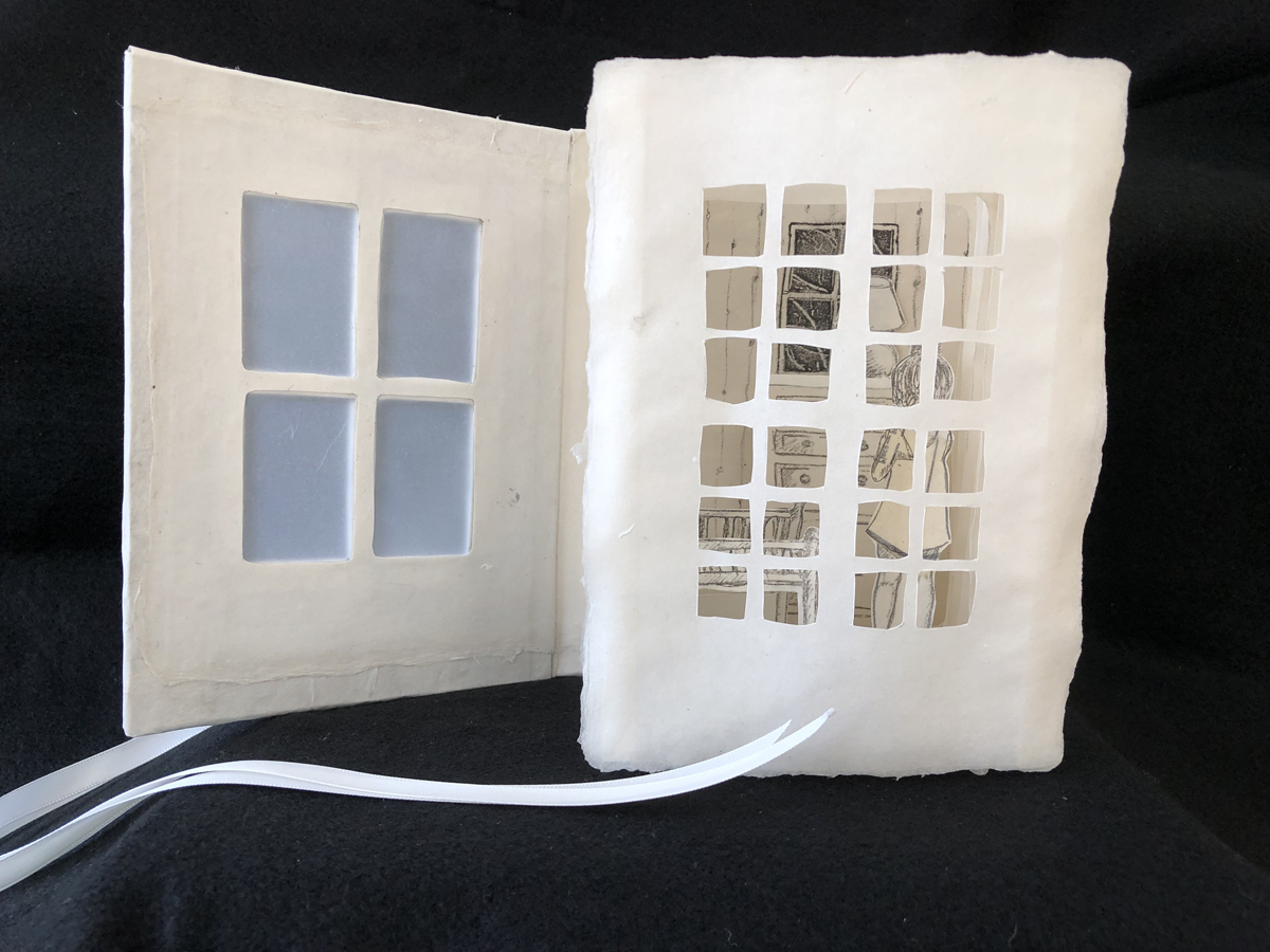 diorama of home viewed through paper window