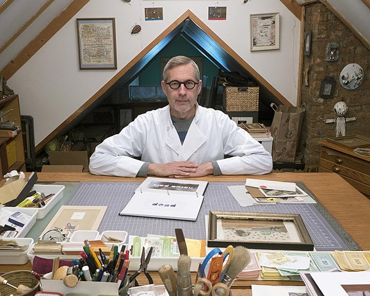 Scott McCarney looks at you from the other side of his workbench