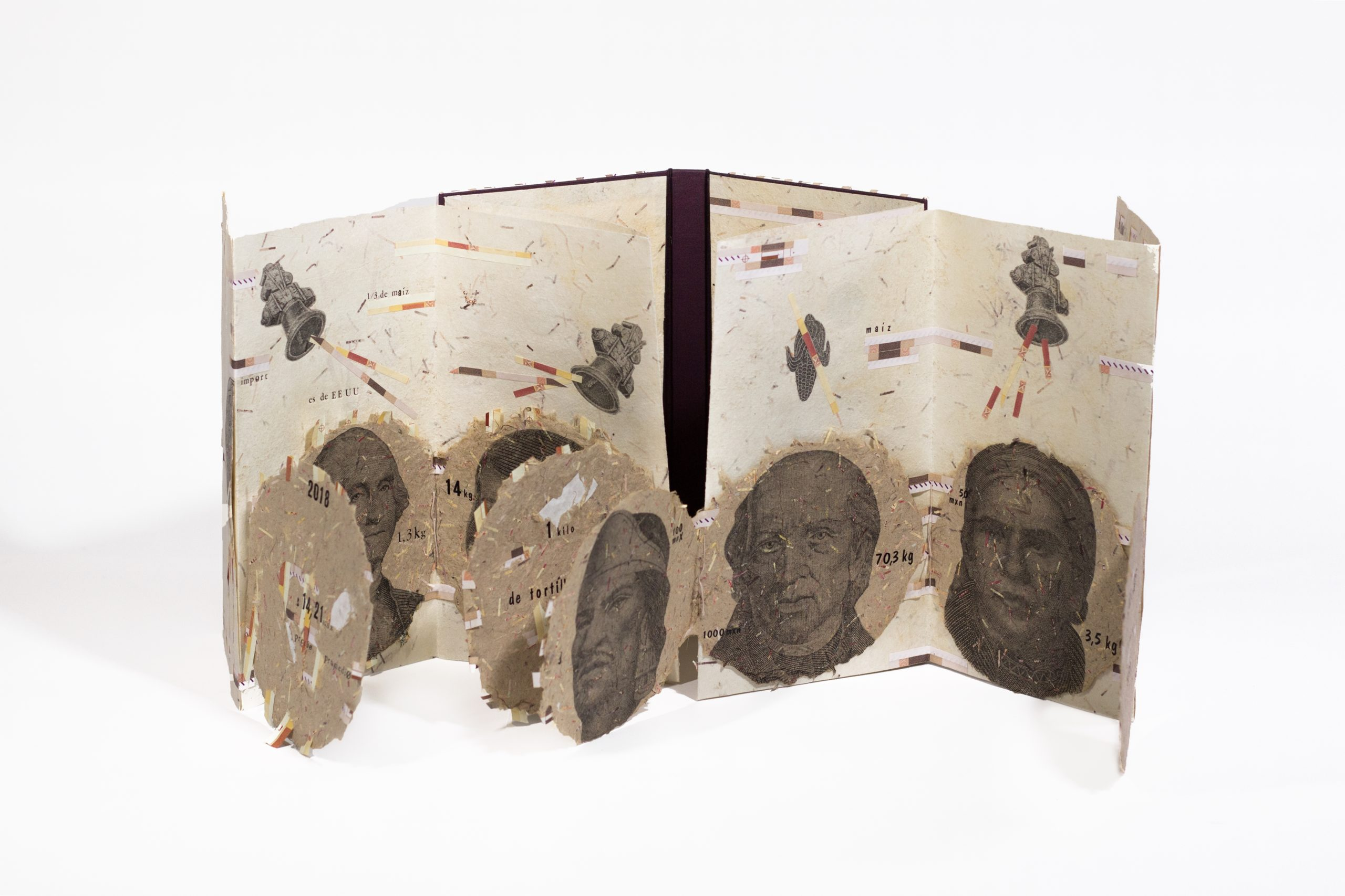 An upright, open book with several image of faces looking at the view
