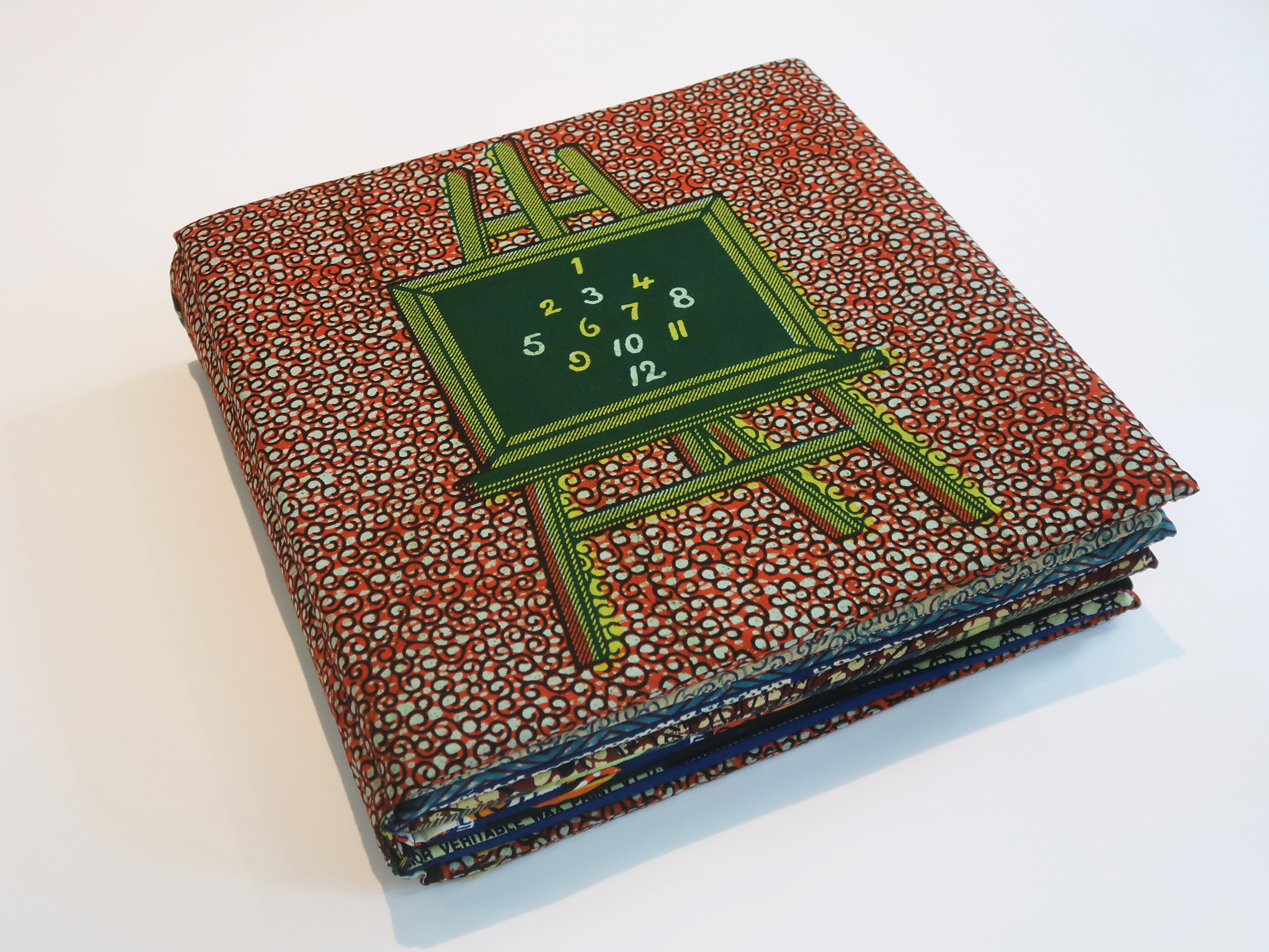 Fabric book with an easel applique on the cover