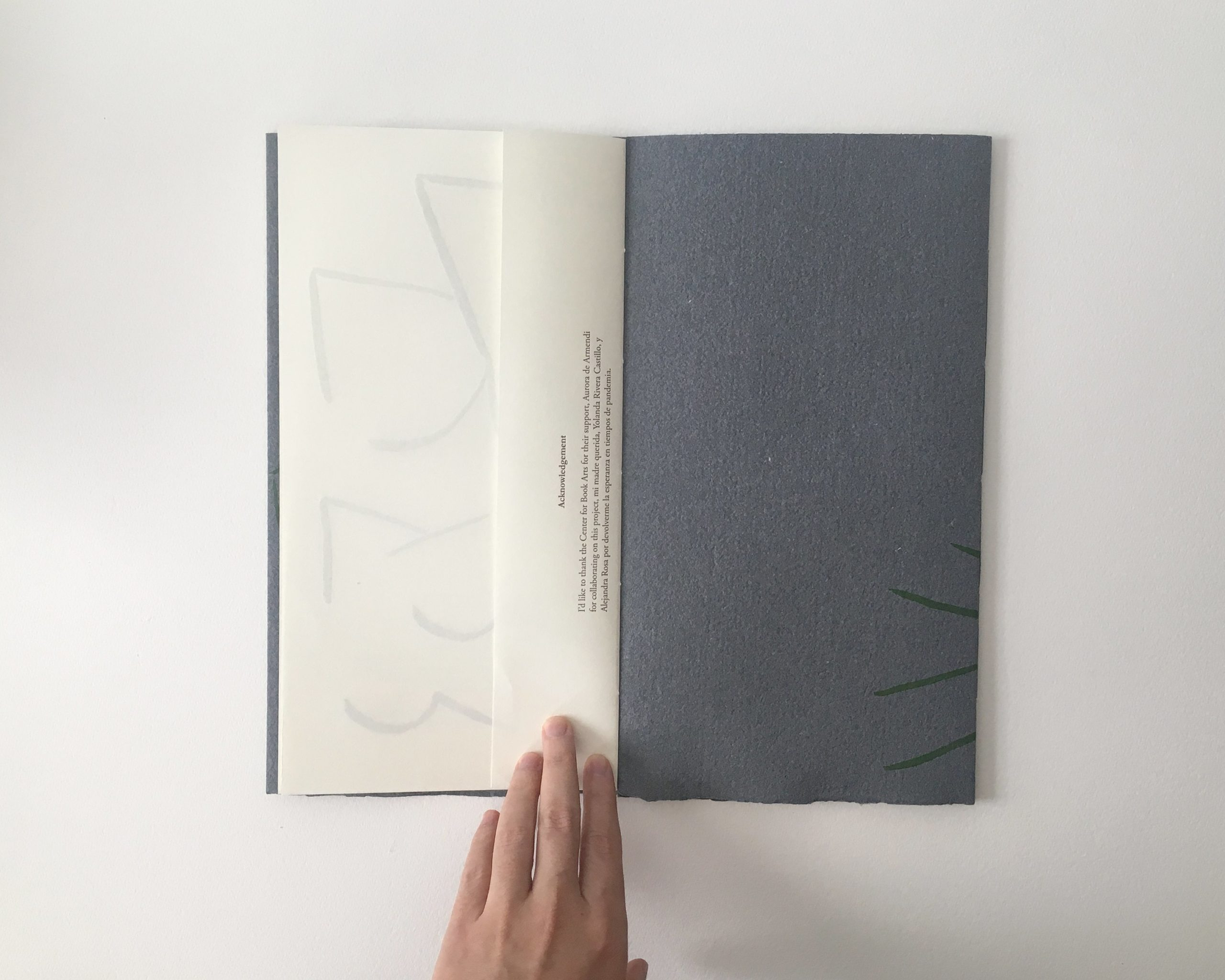 book open to colophon printed on extra short page