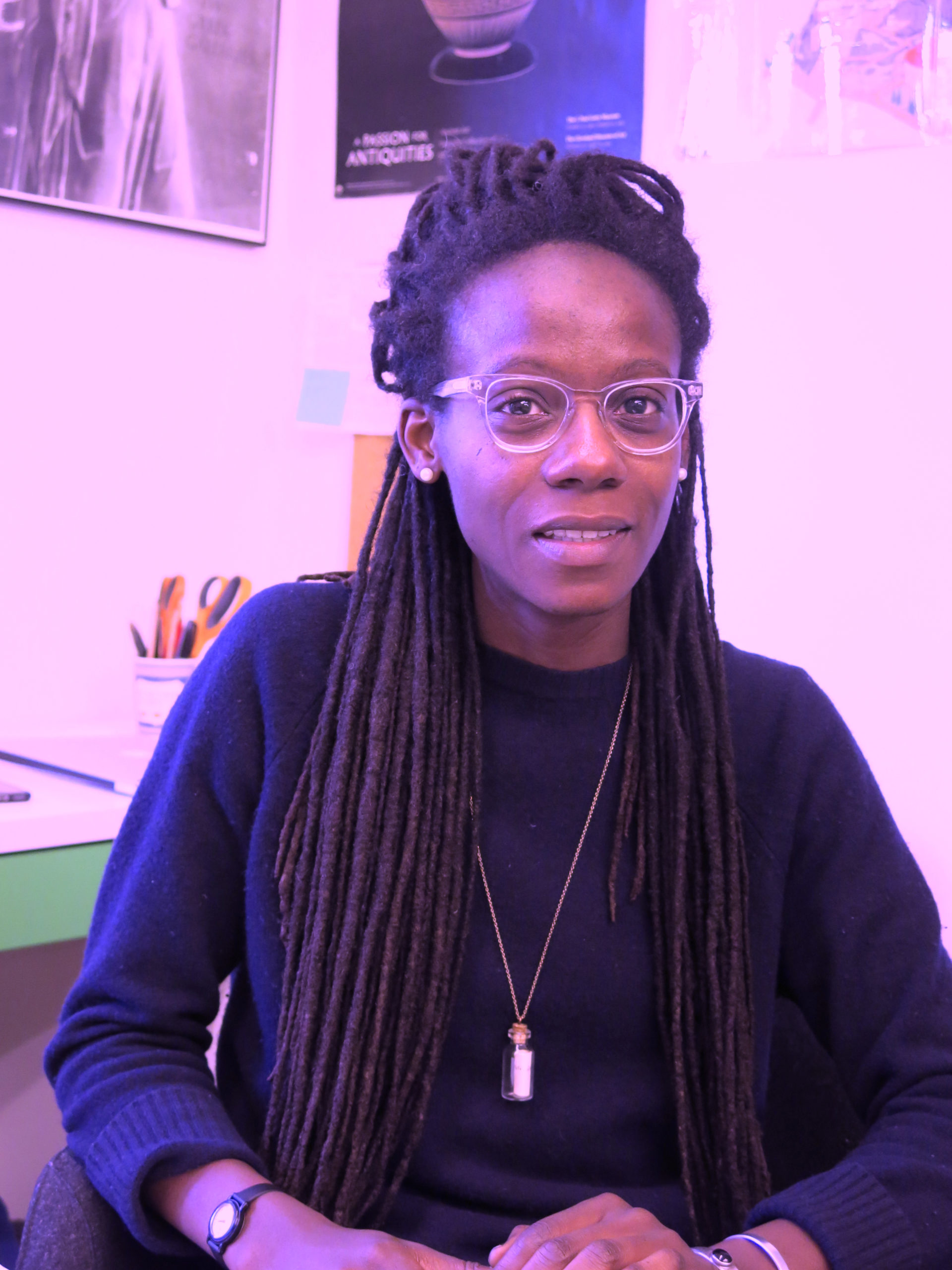 Asiya Wadud with long brown braids and clear glasses