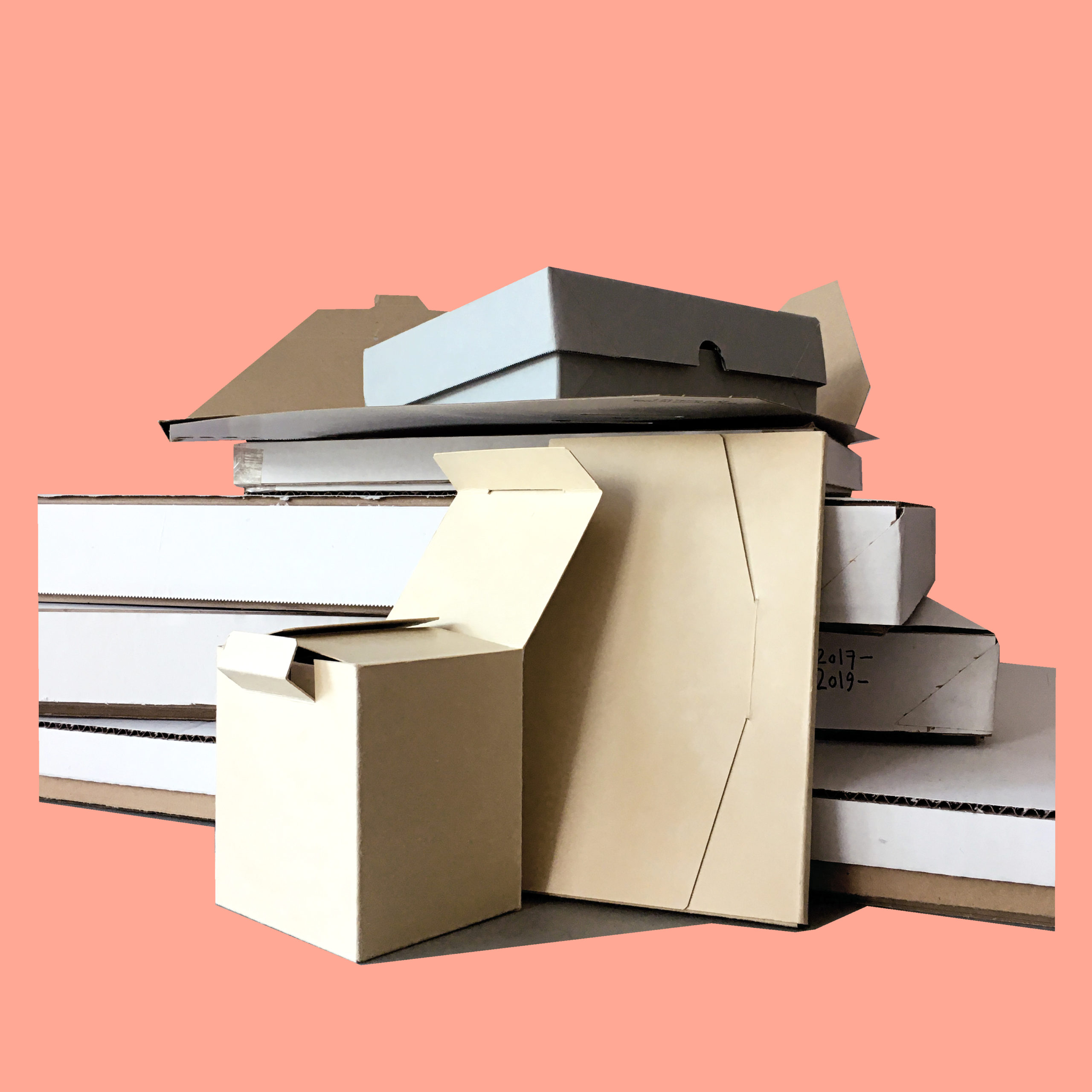 Storage boxes by Milcah Bassel. A collection of boxes made by Milcah for the purpose of storing or holding work. The boxes vary in size and shape.