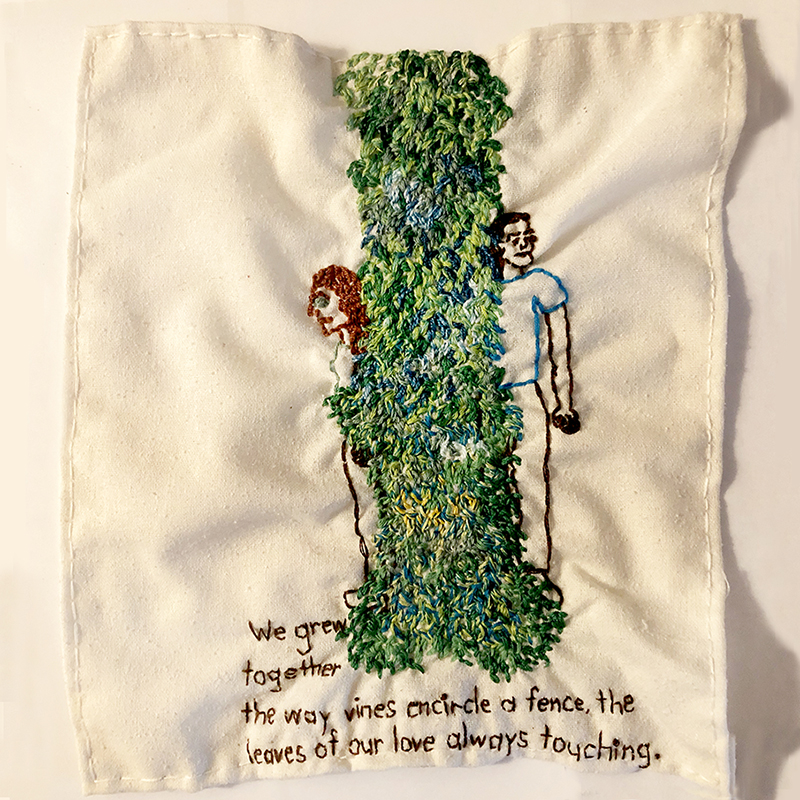 "An embroidered white square by Iviva Olenick. On the square: two lovers are on opposite sides of a thick vine. ""We grew together the way vines encircle a fence, the leaves of our love always touching."" embroidered along the bottom of the page."