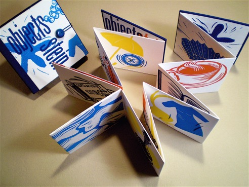 accordion book with images of household objects