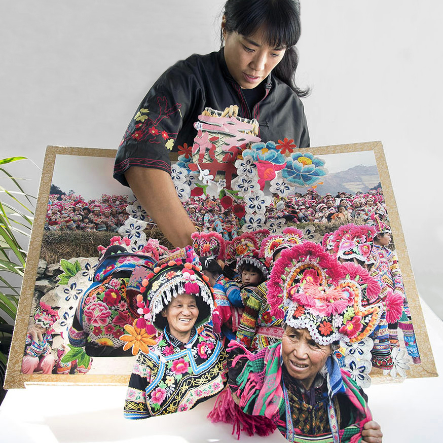 Colette Fu with a large pop-up book entitled: olette Fu: We are Tiger Dragon People.