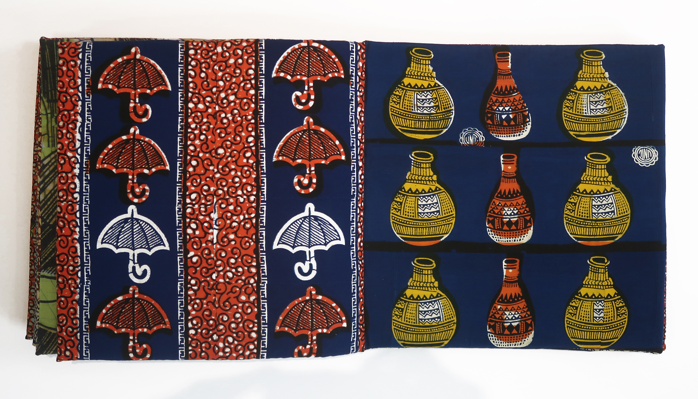 open fabric book with pattern of umbrellas and pots