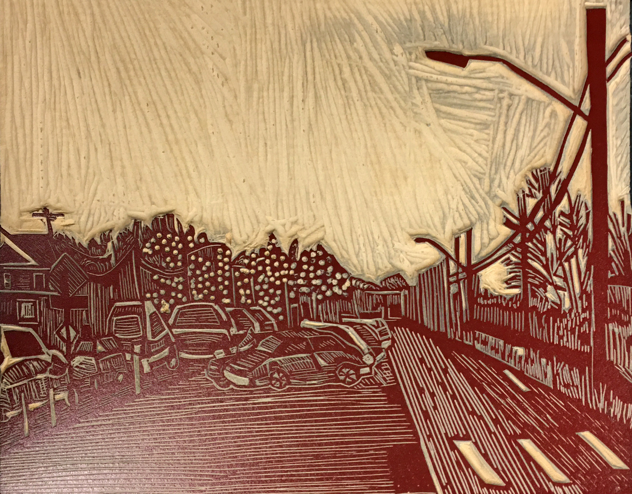 An inked and cut linoleum block. The drawing depicts parked cars, trees, houses, and a street.