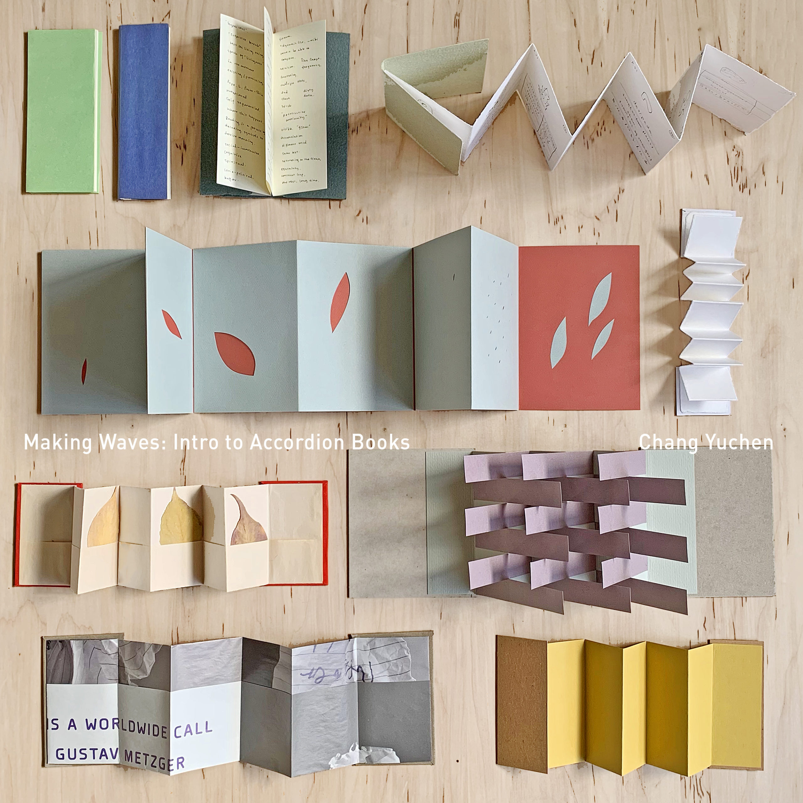 Several colorful examples of accordion fold books are spread out on a wooden table. The title of the class and name of the teacher are typed on the image.