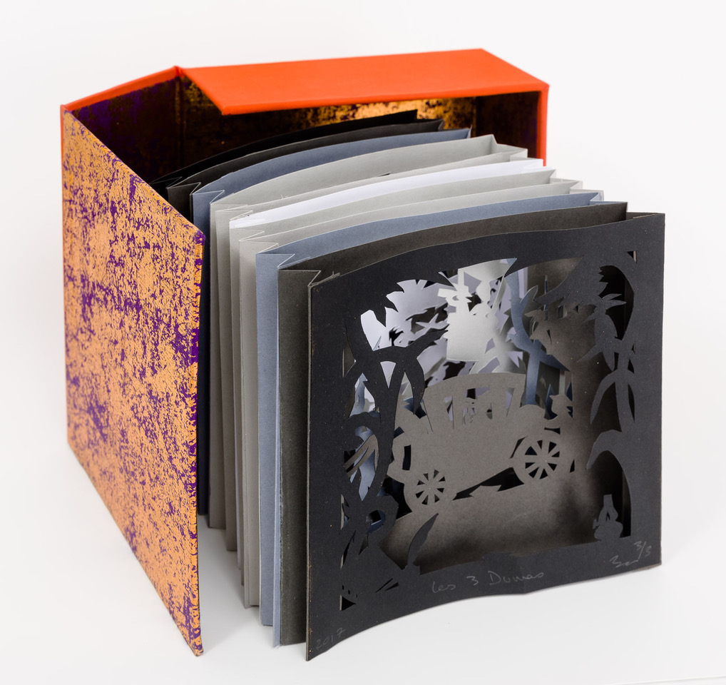 A papercut theater enclosed within a small box by Beatrice Coron