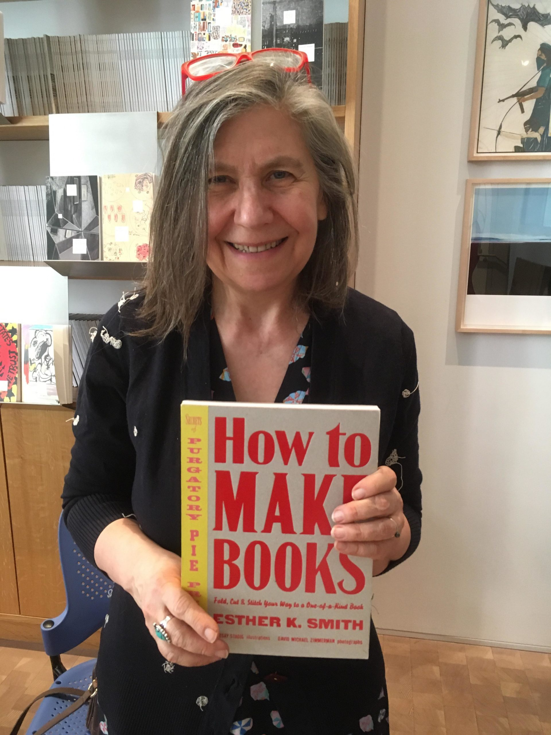 Esther Smith holding her book How to Make Books