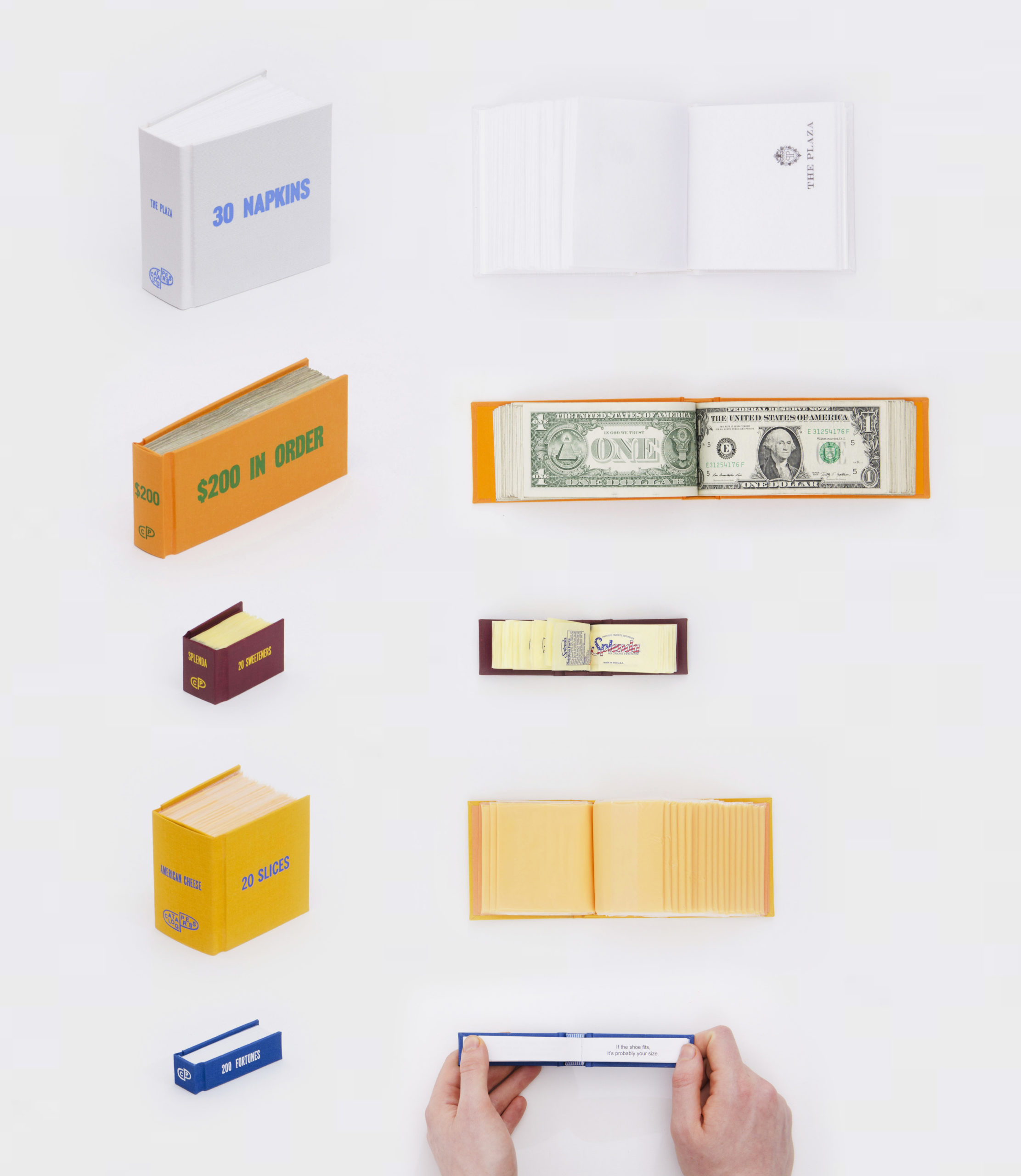 book of napkins, dolar bills, sweetener packets, american chese slices, and fortune cookie fortunes