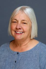 fair skin woman with chin length gray hair