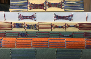 Examples of long & link stitch are stacked on top of one another. The photo shows the details of the spines.