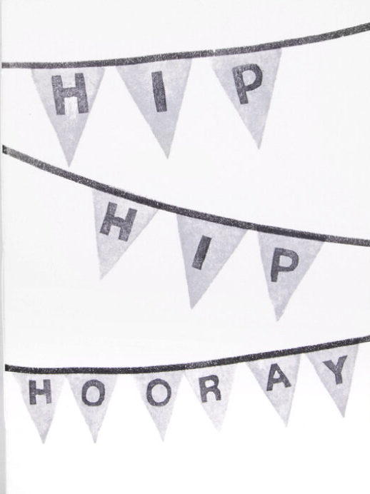 """White closed book over white background. On the cover there is a party light grey garland containing the text """"Hip Hip Hooray""""."""
