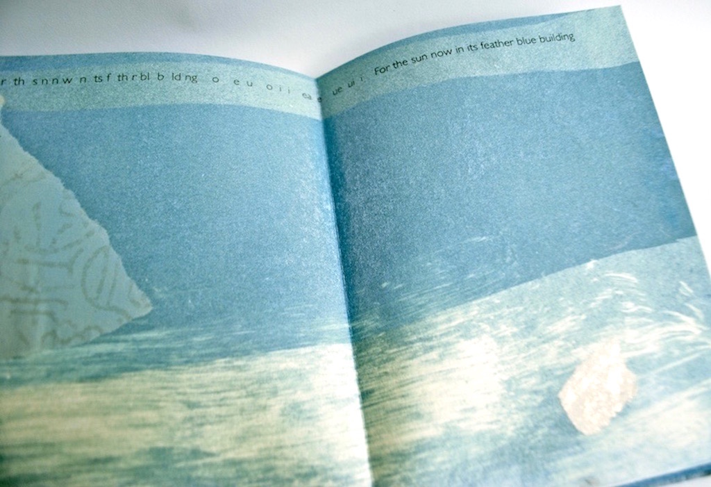 An open pamphlet with a blue tinted image printed across the spread. There is a sentence typed across the spread at the top of the page.