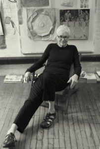 alison knowles sits in her studio