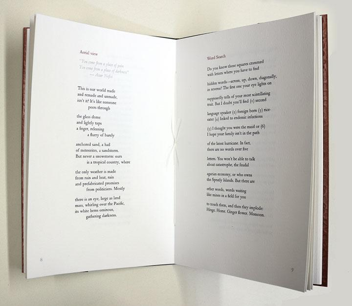 open chapbook with poems letterpress printed in black