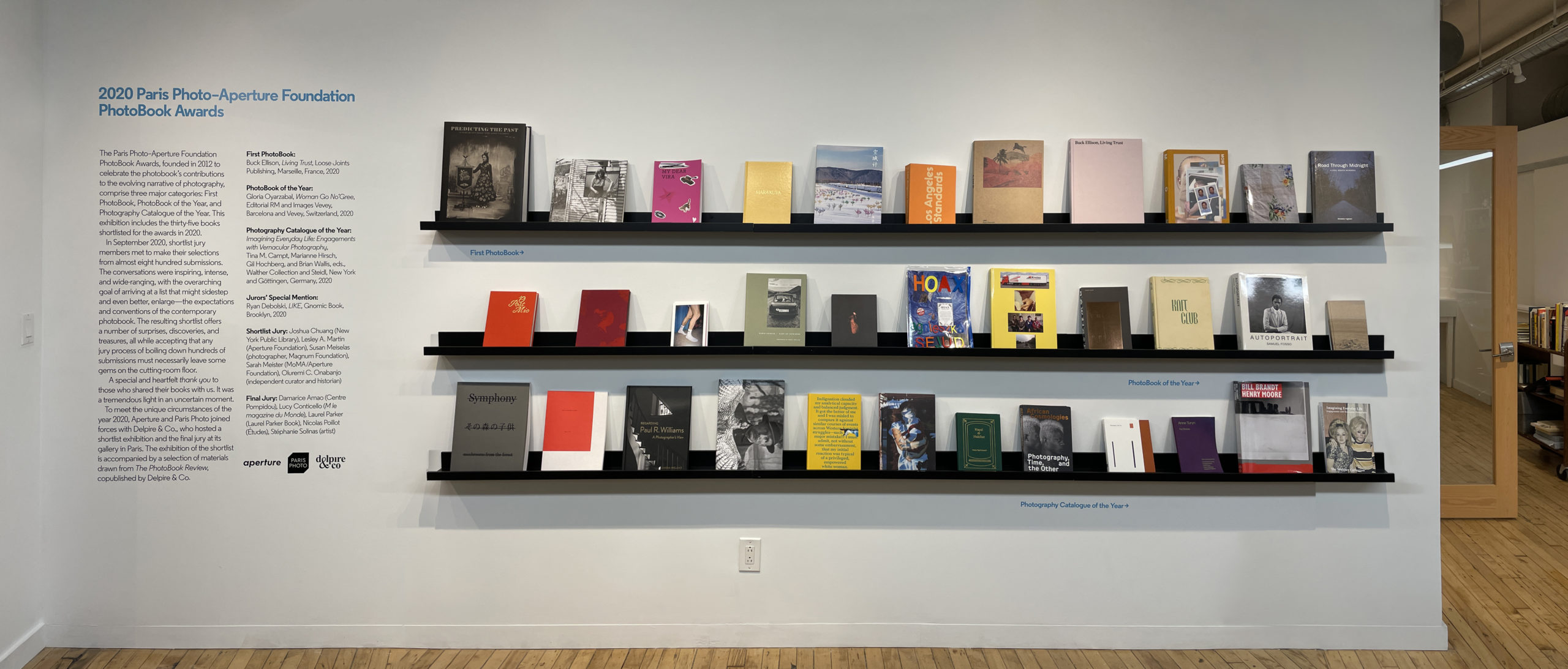 Three rows on books on a wall