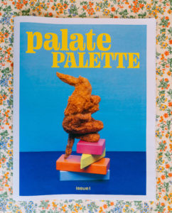 image of fried chicken wings on colorful modular blocks, and a blue background, and title text with yellow font