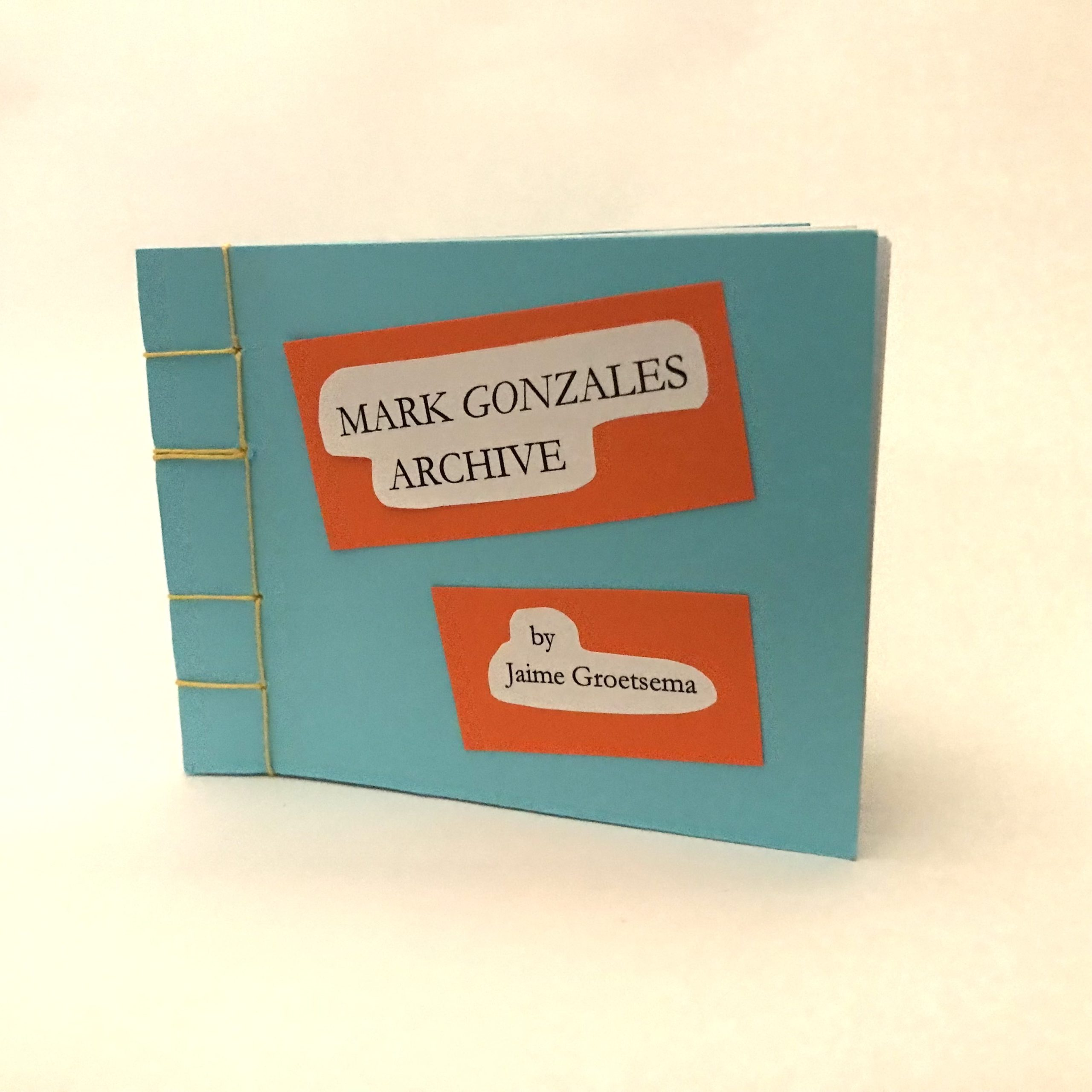 Artists' book standing upright on white background. Artists' book is rectangular with sky blue cover. Book is bound by yellow linen thread on one side in a stab-stitch style. Two rectangular labels are adhered to the cover. The labels are white, surrounded by an orange boarder. The label nearest the top of the cover reads: Mark Gonzales Archive; the label near the bottom of the cover reads: by: Jaime Groetsema.