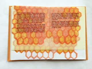 image of open book with printed image and text.