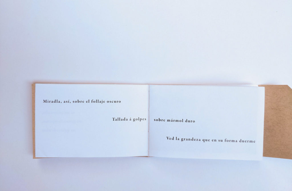 """Open spread showing pages four and five of the book, black text on white paper: one verse of poetry across the top center of the spread reads """"Mas pobre que un guisano siempre en calma!"""" At the far right edge of the spread, two verses in slightly smaller text read """"Que sea Azucena / sobre todas, casta."""" At the bottom center of the spread is a small half-moon shaped cut-out, signaling that the page can be folded upward."""